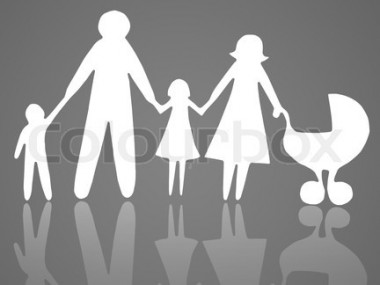 Closeup of paper family on grey background